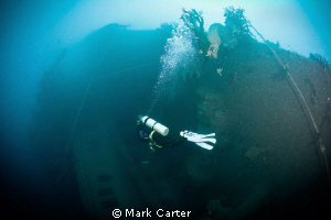 diver returning from the stern of the SS President coolid... by Mark Carter